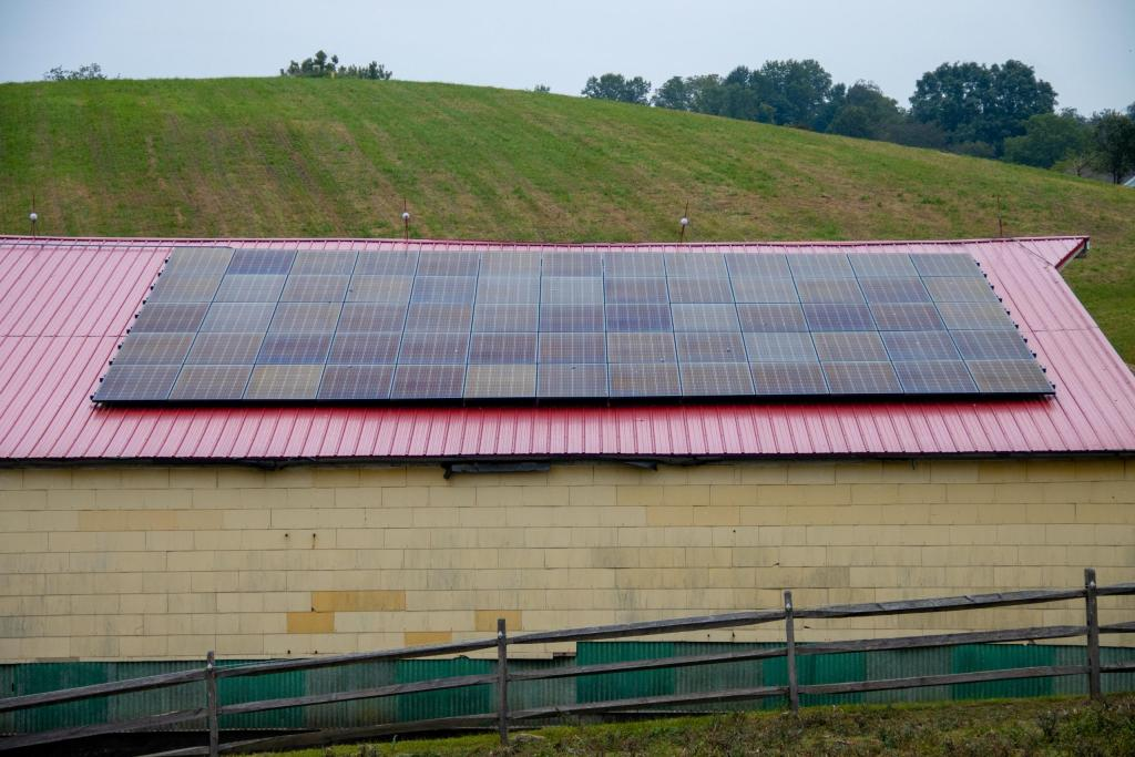 Solar panels are attached to the roof of a feed barn as a source of renewable energy at Justa Farm.