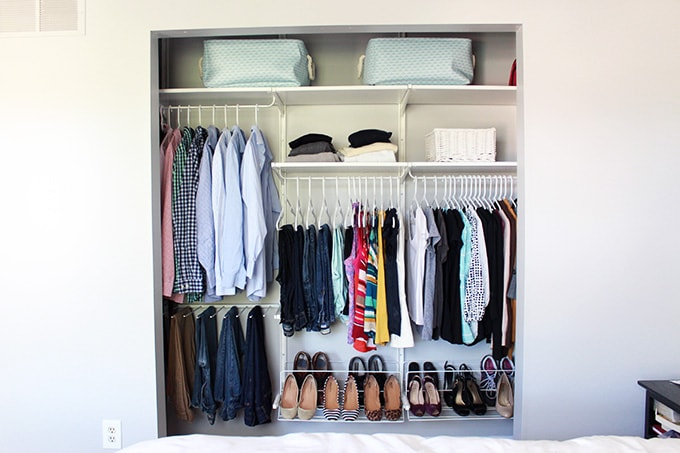 I love how they really made the most of this small closet! Great ideas for organizing everything! Click through to the post for all of her organization tips and tricks! | JustAGirlAndHerBlog.com