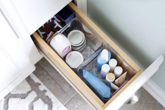 I'm sharing all of my favorite master bathroom organization ideas and some easy updates that we've done to take our master bathroom from cluttered and boring to organized and beautiful! | bathroom organization, organized bathroom vanity, how to organize a bathroom, how to organize deep vanity drawers, organized hair supplies, shaving tools organization, organized skin care and nail care items