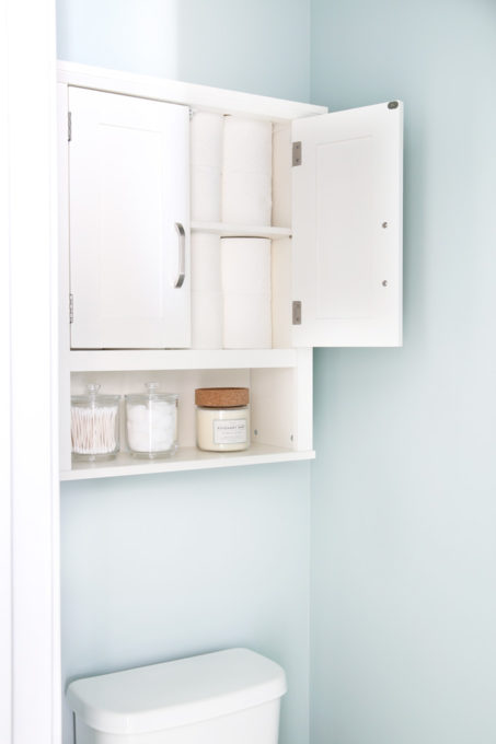 I'm sharing all of my favorite master bathroom organization ideas and some easy updates that we've done to take our master bathroom from cluttered and boring to organized and beautiful! | bathroom organization, organized bathroom vanity, how to organize a bathroom, how to organize deep vanity drawers, organized hair supplies, shaving tools organization, wall cabinet to hold toilet paper in water closet
