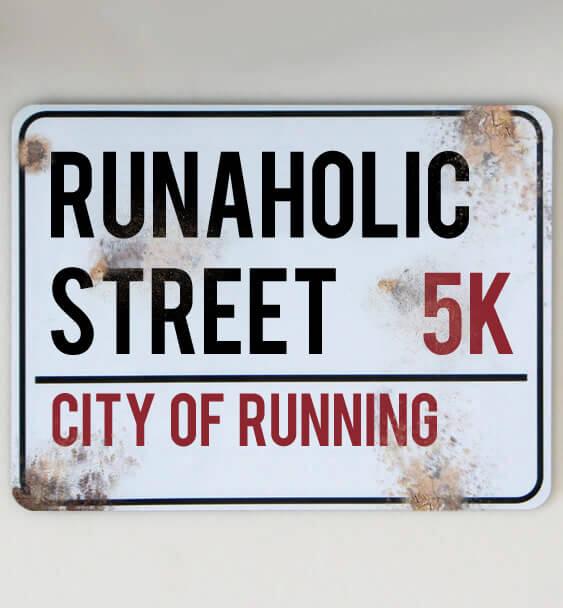metal street sign running 5