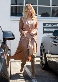 Khloe Kardashian roams the streets in her soft peach coloured silk robe