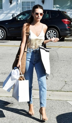 Emily Ratajkowski pairs her silk cami with jeans and a pair of heels for an effortless sexy look