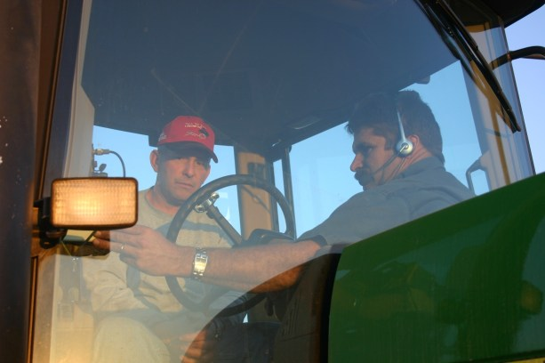 Rod and agronomist Ken Ferrie setting up a variable rate map in the tractor