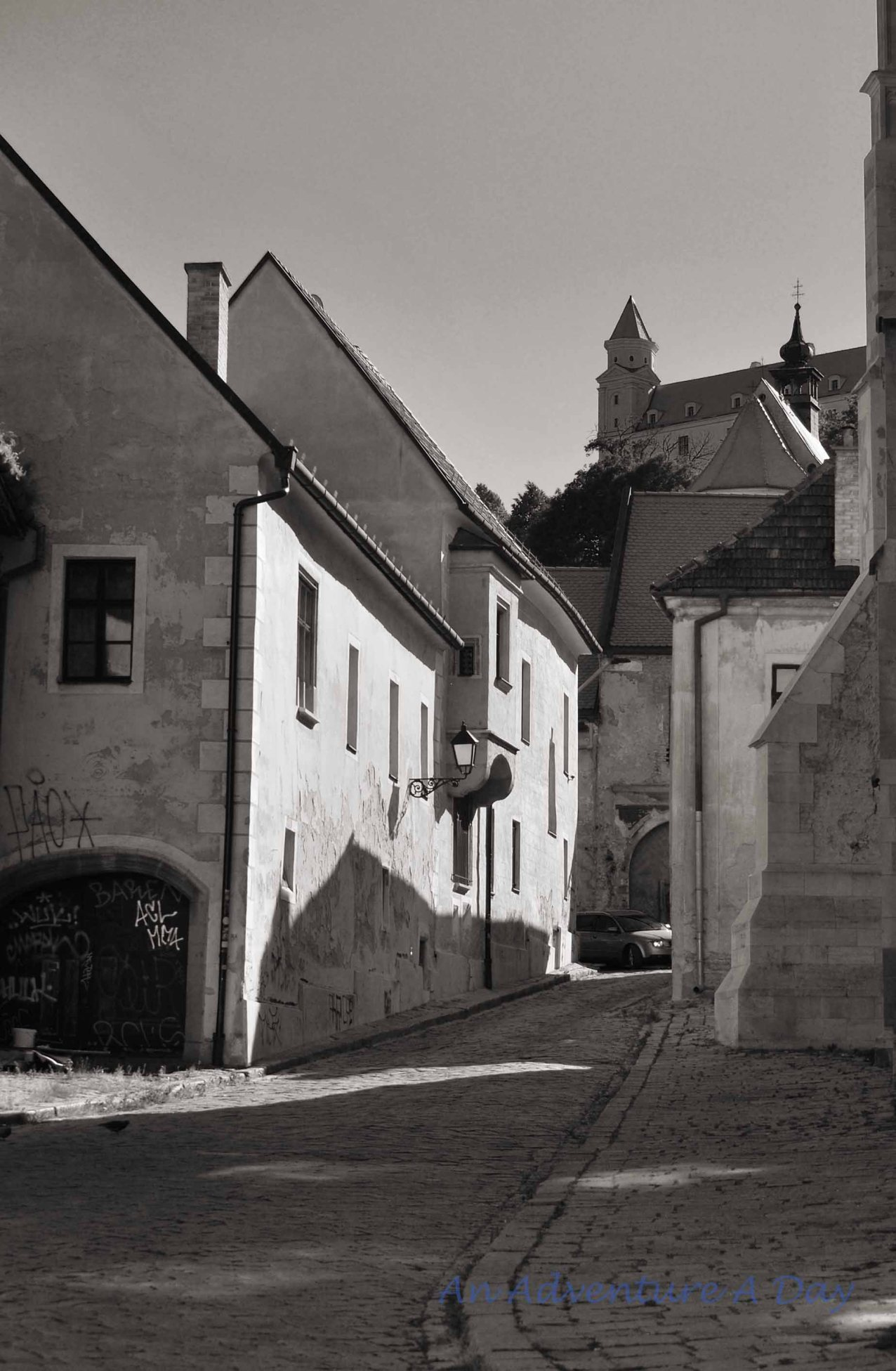 A side street in lovely Bratislava with a view of the castle.