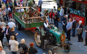 Tractors lead the procession through the streets of Mayrhofen