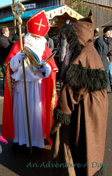 Saint Nicholas and Knecht Rubrecht visit on Saint Nicholas day - December 6. At the Christmas Market in Bad Bucheim