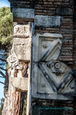 Details that remain on a tomb on the Appia Antica.