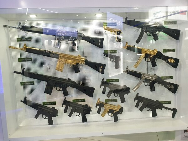 A Pakistani booth shows off gold-plated guns at IDEX 2021. (Agnes Helou/Staff)