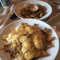 Fried Pickles (background), Duck Confit Poutine (foreground)