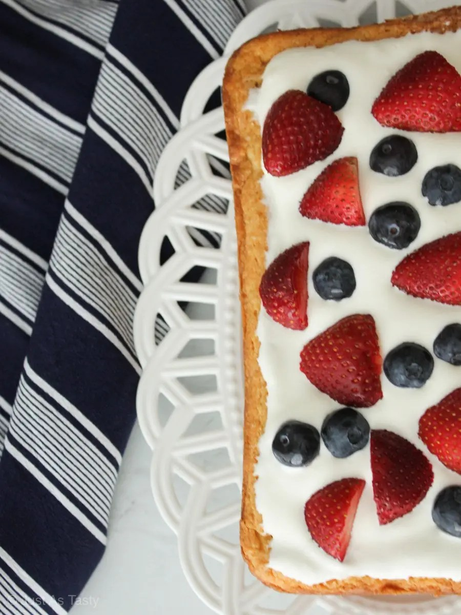Rectangle cake topped with whipped cream and berries