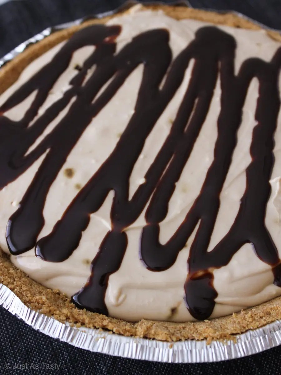 Round cheesecake topped with chocolate drizzle