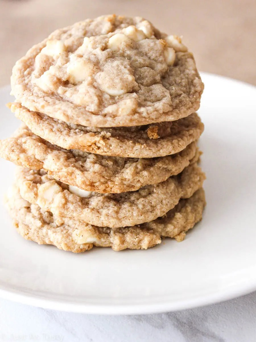Stack of apple pie cookies on a white plate.