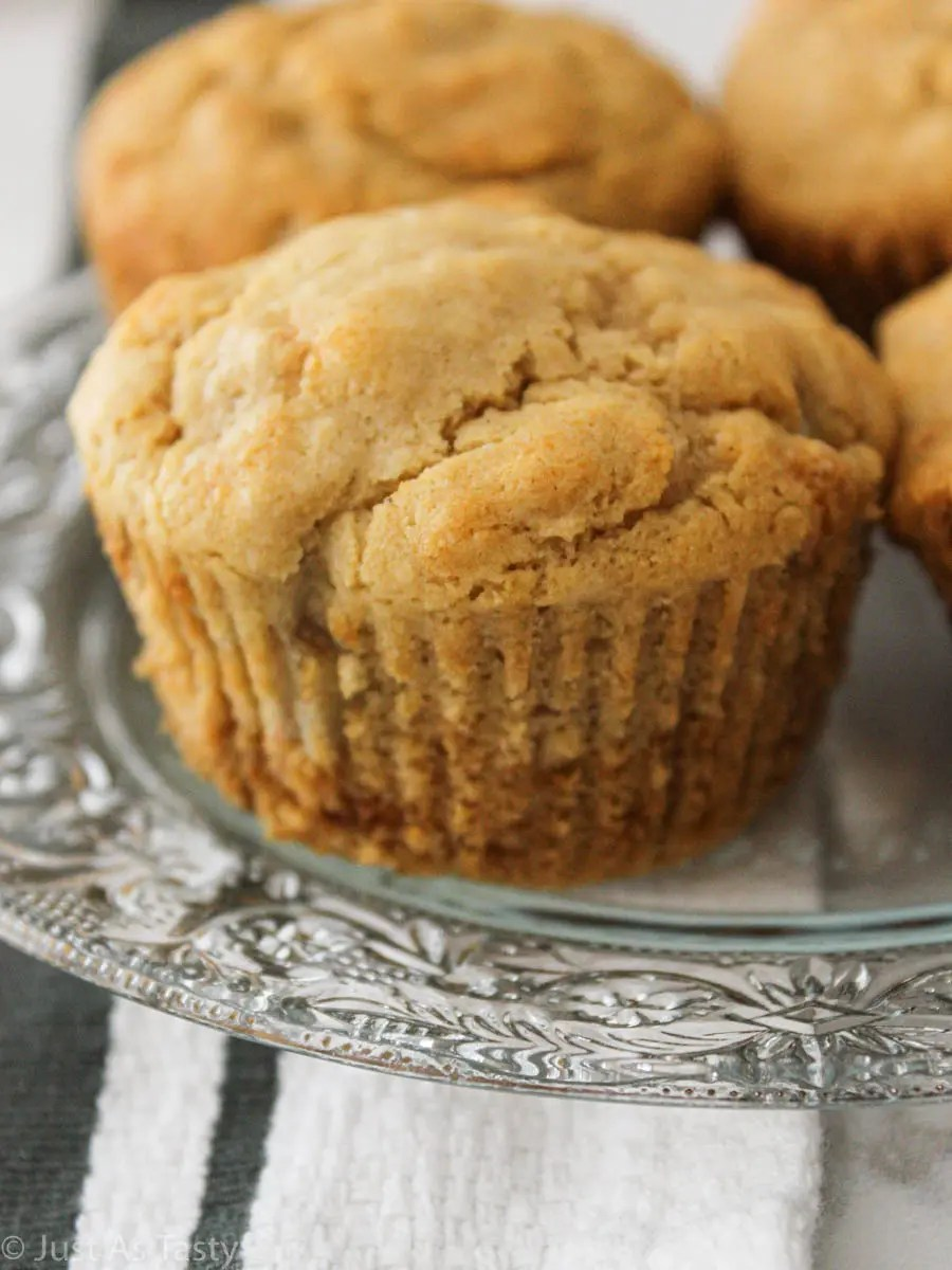 Close-up of easy banana muffins on a glass plate.