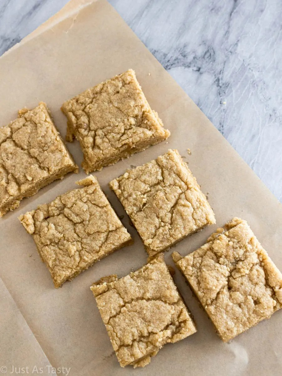 Eggless blonde brownies on parchment paper.