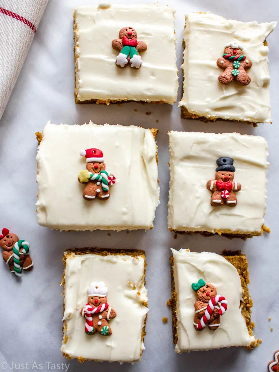 Sliced gluten free gingerbread bars topped with cream cheese frosting.