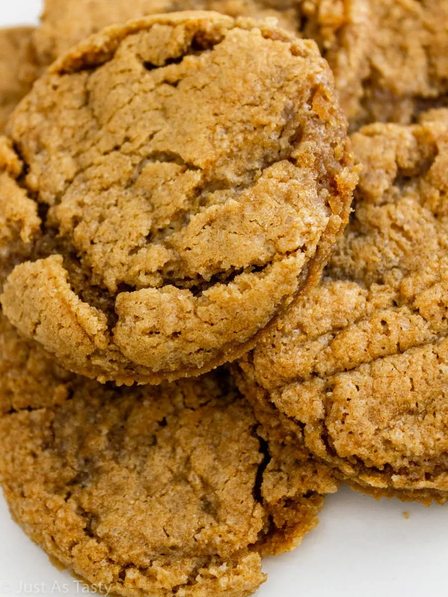 Close-up of gluten free maple cookies on a white plate.
