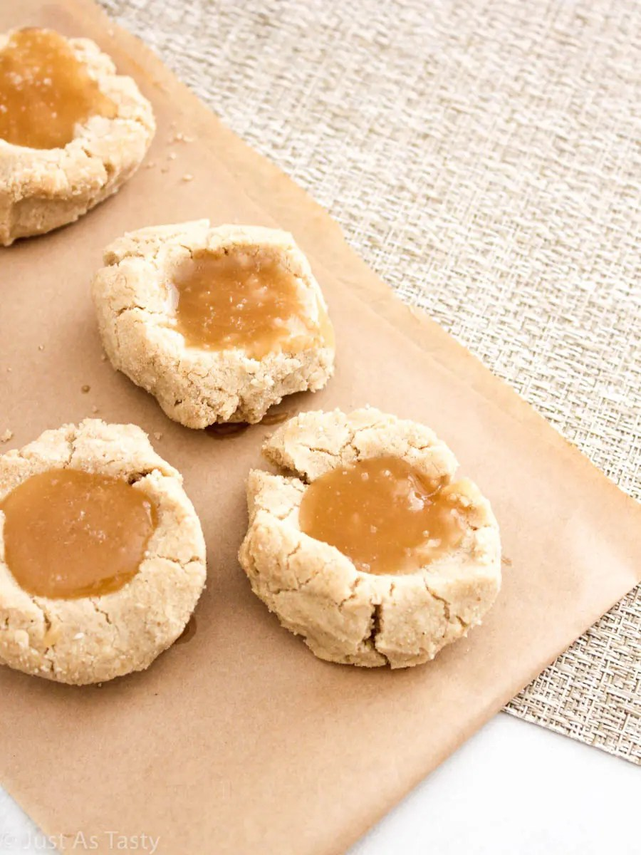 Salted caramel cookies on parchment paper.