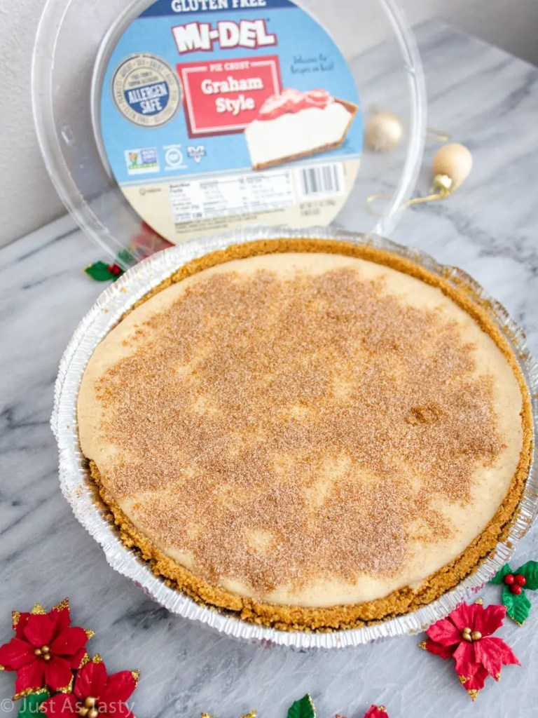 Snickerdoodle cheesecake on a marble surface.