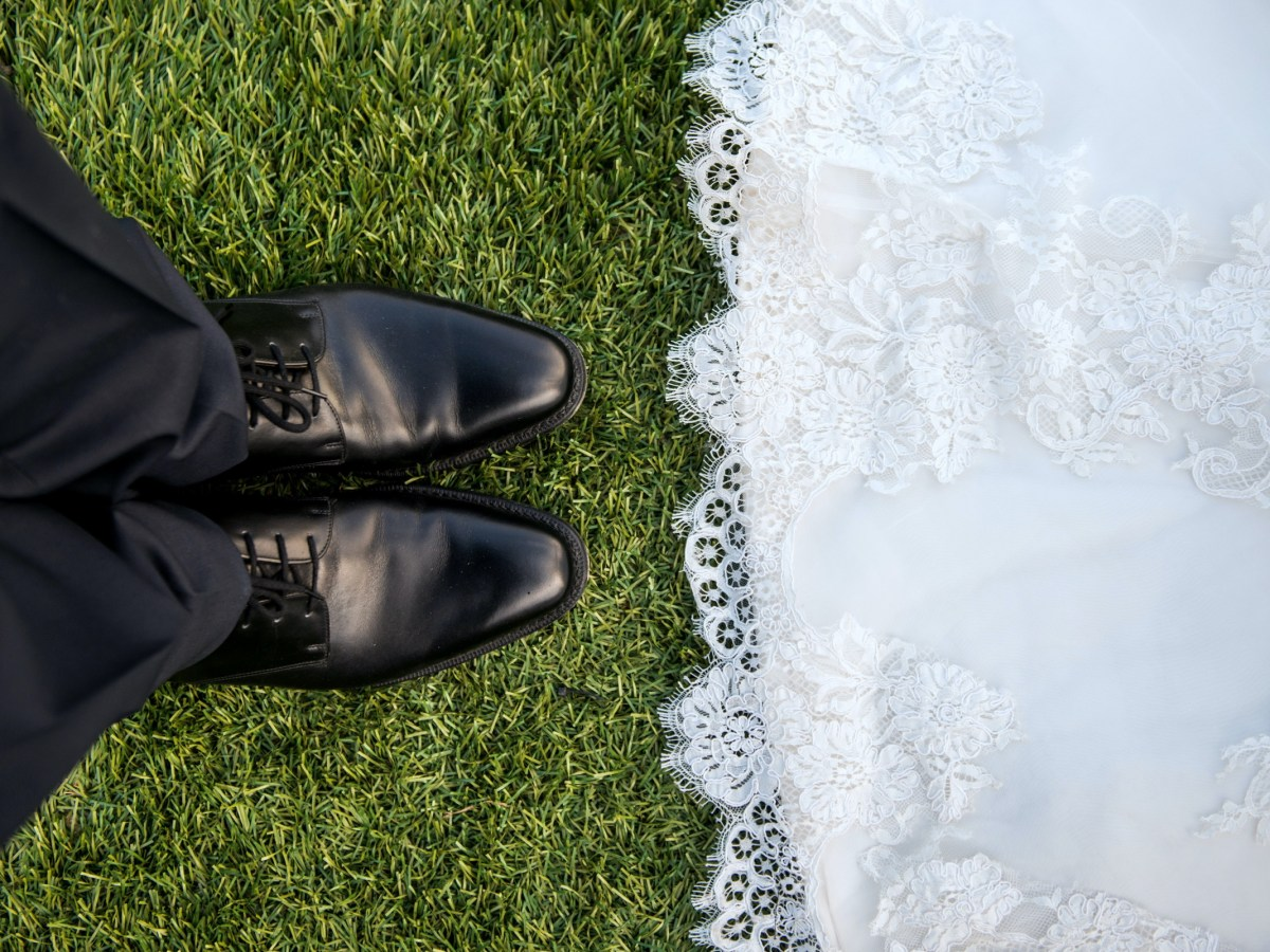 looking down at the bride and groom's feet