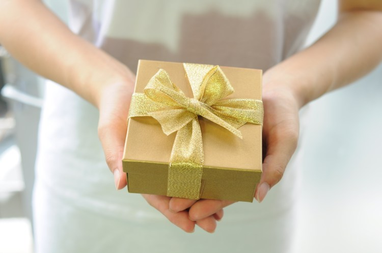 woman holding a gold box