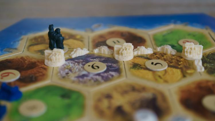 row of settlements on a Catan board