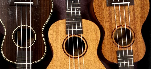 three ukuleles made from different woods