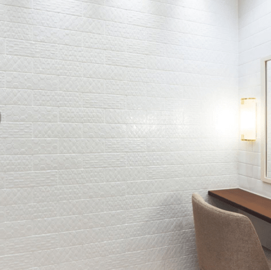 a wall of white tiles