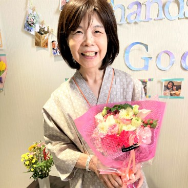 Mum holding a bouquet of flowers on her 73rd birthday