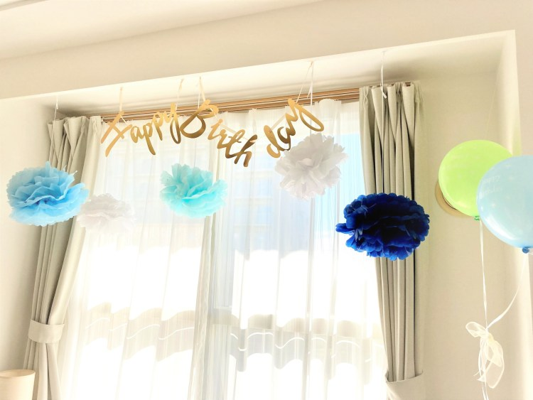 lounge room window with blue birthday decorations