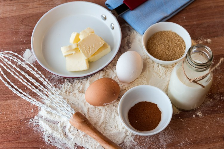 cooking ingredients laid out on top of a wooden table