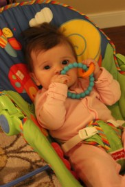 Playing with her new teether.