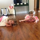 Lola teaching Olive to crawl.