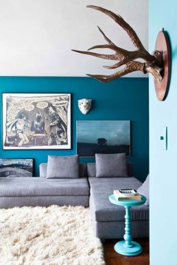 Different blue hues grounded by grey couch