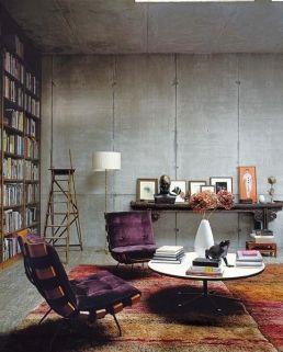 Concrete is warmed up with purple furnishings