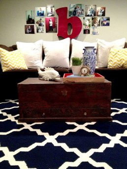 Arrange the knick knacks in a tray and emphasize an item outside the tray