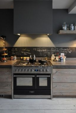 Use of metals, natural counter top materials and raw wood cabinets