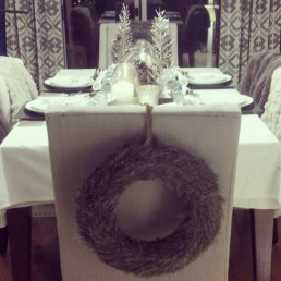 christmas table setting with fur throws