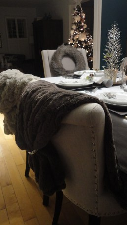 Taupe faux fur draped over chair