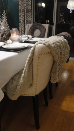 Creme faux fur draped over chair