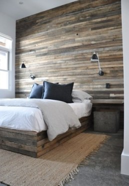 raw wood a head board wall and bed frame