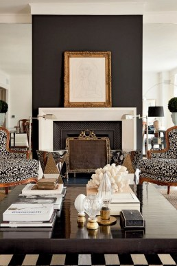 living room with black fireplace wall