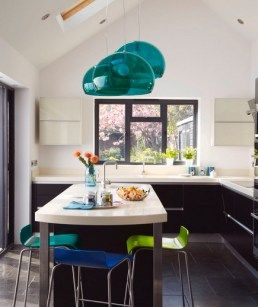 Cluster pendents are a great way to add color to a kitchen