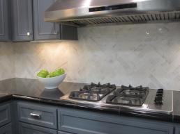 Carrara marble herring bone kitchen backsplash