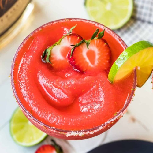 frozen margarita with strawberries and limes drink