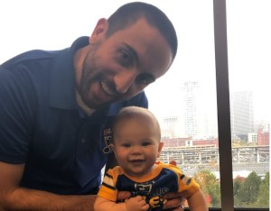 Ben Holding his Son Jackson Gillham, who dressed as a St. Louis Blues Hockey Player for his first Halloween