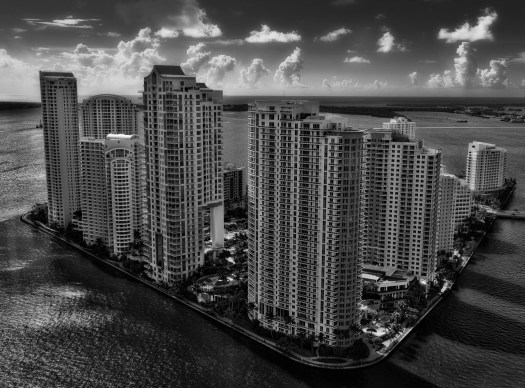 A birds-eye view of a little island in the middle of Miami. I took this from a hotel when I was down here recently. At night I sat in a lounge on the 36th floor and was surprised to find that most of these units were dark. I thought that was a little odd because as compared to other cities like New York or Vancouver. But then this is the middle of summer in Florida and I suppose most of these units are second homes or vacation getaways. Perhaps if I come back here in winter these will be all lit up like Christmas trees with escapees from colder climates.