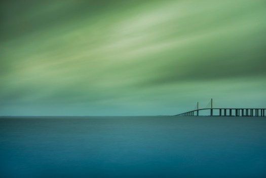 It's warm and humid here in central Florida and this evening the clouds were heavy and thick. So I headed over to the Skyway Bridge to capture this. As I was here some dolphins swam by, ships passed under the bridge, and pelicans looked for scraps from the fishermen. All in all, just another lazy Sunday evening.