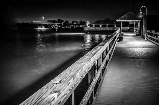 The Bridge Street Pier in Bradenton Beach Florida. The bridge is adjacent to the pier and so at this early hour  a few early commuters are crossing the bridge on the way to work. I took this about a month back just as the pier re-opened from an extensive renovation. A great place to hang out if you're ever in the area. And if you do come in the morning there is a restaurant here that opens early so you can sit  with your cup of coffee and enjoy the scenery.