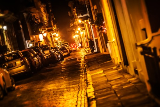 This is the old town section of San Juan Puerto Rico where I recently found myself on a Friday night. After an authentic meal at El Jibarito we spotted a coconut vendor who provided fresh coconut water, something I could get used to. By the time we left this section of town it was filling up with Friday night party goers and it took our cab about a half hour to navigate the narrow oneway cobblestone streets. Not that I minded that slow ride one bit.